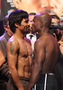 Manny Pacquiao (left) faces off with Timothy Bradley during the weigh-in ceremony at the MGM Grand Garden Arena in Las Vegas on June 9, 2012.  An estimated crowd of 4,000 fans were on hand for the event.  Pacquiao and Bradley will face each other once again on June 10th to decide the WBO World Welterweight championship.