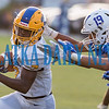 Palatka junior Delton Nealy (7) avoids the grasp of several Clay defenders in the first half. Fran Ruchalski/Palatka Daily News
