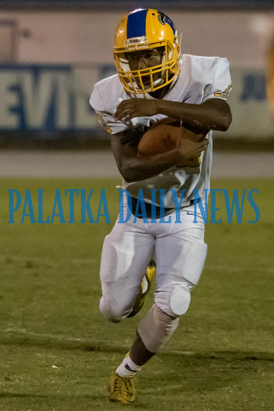 Palatka sophomore Sam Smith (23) carries the ball in the third quarter in the game against Clay. Fran Ruchalski/Palatka Daily News