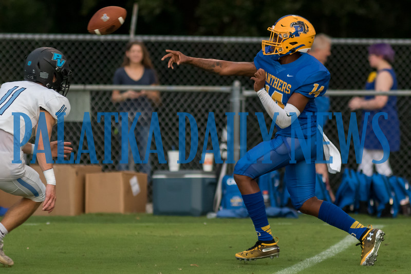 Palatka quarterback Demontae Ashley (14) tosses a forward pass while scampering down the sideline in the first half of their game against Ponte Vedra. Fran Ruchalski/Palatka Daily News