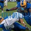Palnthers Isiah Dixon (28) and Marlon Williams (70) converge on a tackle of Ponte Vedra ball carrier XXX (26) in the first half of their game. Fran Ruchalski/Palatka Daily News