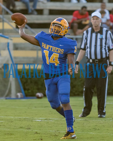 Panthers quarterback Damontae Ashley (14) unloads a pass in the first half of their game on Friday night against Menendez. Fran Ruchalski/Palatka Daily News