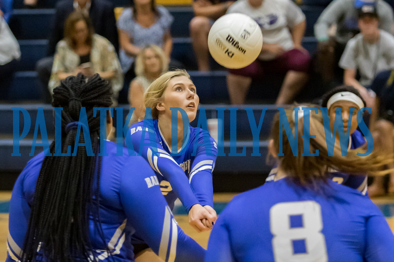 Interlachen's Kirby Mason (2) pops the ball back over the net in the first set of their match against Palatka. Fran Ruchalski/Palatka Daily News
