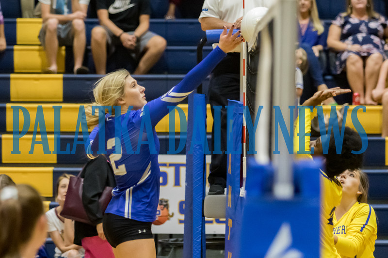 Interlachen's Kirby Mason (2) finesses the ball  over the net in the third set of their match against Palatka. Fran Ruchalski/Palatka Daily News