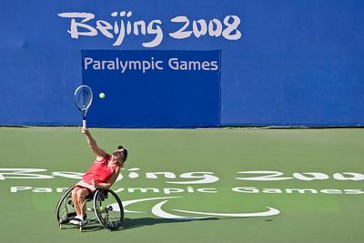 US athlete Beth Arnoult serving during singles match