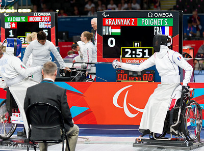 Wheelchair Fencing at Excel, 7 September, 2012.  Sabrina Poignet of France takes on Zsussanna Krajnyak of Hungary in the quarter final team match.   France lost a close contest 45-41.