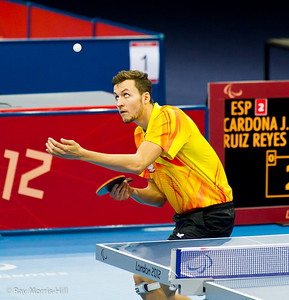 Table Tennis at Excel, 7 September 2012. Poland on their way to defeating Spain in their Men's Team Class 9-10 semi-final. Patryk Chojnowzki serving.