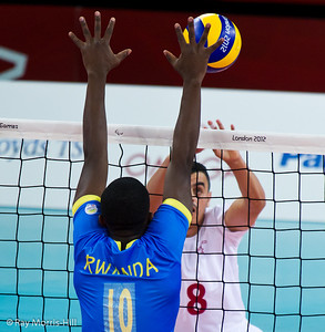 Sitting Volleyball at Excel, 7 September 2012. Great block by Rwanda's Fulgence Hagenimana.  Rwanda won 3-1 against Morocco in the 9-10 Classification match. It was the first ever victory by a sub-Saharan African team.