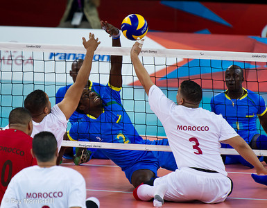 Sitting Volleyball at Excel, 7 September 2012. Vincent Tuyisenge defends against Morocco's Hicham El Jamili  Rwanda won 3-1 against Morocco in the 9-10 Classification match. It was the first ever victory by a sub-Saharan African team.