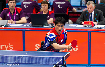 Table Tennis at Excel, 7 September 2012. Jeon Seok Kim returns serve in the Men's Team Bronze Medal match (Class 3) between South Korea and France.  France won 3-1