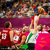 Australia beat Poland 76-53.  Stibners takes aim, watched by Mosler and Filipski