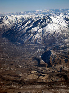 "Salt Lake City valley and ""twin peaks"", on left is Broad Forks Twin Peaks, on right is Lone Peak and Mount Timpanogos, all >11,000 feet. Major obvious valley is Cottonwood canyon, which connects to Alta / Solitude / Snowbird ski areas."