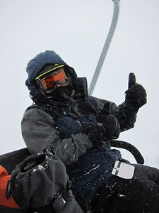Rob during brutal day at Alta - white out conditions, 15 mph winds, temp 15 degrees, so key was to minimize exposed skin (hence hood, mask) to enjoy the fresh snow.