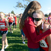 """Fairview High School junior Isabelle Kennedy, right, is hugged by her friend Josie Hoyt after winning the varsity girls race during the Pat Patten cross country invitational on Friday, Sept. 28, at Harlow Platts Community Park in Boulder. For more photos of the event go to  <a href=""""http://www.dailycamera.com"""">http://www.dailycamera.com</a><br /> Jeremy Papasso/ Camera"""