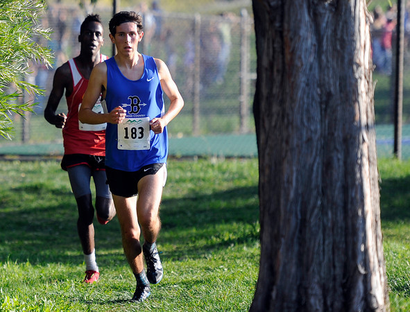 """Broomfield High School's Ethan Gonzales, front, leads Ashi Geberkidane in the varsity boys race during the Pat Patten cross country invitational on Friday, Sept. 28, at Harlow Platts Community Park in Boulder. For more photos of the event go to  <a href=""""http://www.dailycamera.com"""">http://www.dailycamera.com</a><br /> Jeremy Papasso/ Camera"""