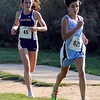 """Ralson Valley High School's Nicole Hahn, right, and Boulder High School's Erin McLaughlin keep pace with each other during the Pat Patten cross country invitational on Friday, Sept. 28, at Harlow Platts Community Park in Boulder. Hahn place second and McLaughlin third in the varsity girls race. For more photos of the event go to  <a href=""""http://www.dailycamera.com"""">http://www.dailycamera.com</a><br /> Jeremy Papasso/ Camera"""