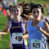 "Ralston Valley High School's Nicole Hahn, right, and Boulder High School's Erin McLaughlin cross the finish line during the Pat Patten cross country invitational on Friday, Sept. 28, at Harlow Platts Community Park in Boulder. Hahn placed second and McLaughlin third. For more photos of the event go to  <a href=""http://www.dailycamera.com"">http://www.dailycamera.com</a><br /> Jeremy Papasso/ Camera"