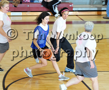 Phillipsburg, NJ, 11/21/2009: Phillipsburg High School alumni, Robin Brunetti -Barlow, left works the ball around her sister, Gina Brunetti-Perini, during the first annual Phillipsburg High School alumni girls basketball tournament Saturday at the school. Proceeds from the event will benefit the Susan B. Kromen Breast Cancer Fund. Express-Times Photo | TIM WYNKOOP