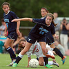 Peabody midfielder Molly Tansey (14) tries to keep control of the ball while being tied up by Beverly midfielder Aly Barr (17) during the second half of play on Thursday afternoon. DAVID LE/Staff photo. 9/11/14.