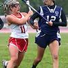 KEN YUSZKUS/Staff photo. Masco Molly Gillespie, left, holds onto the ball despite Peabody's Mia Lomansey best efforts during the Peabody at Masconomet girls lacrosse state tournament game.     6/01/15