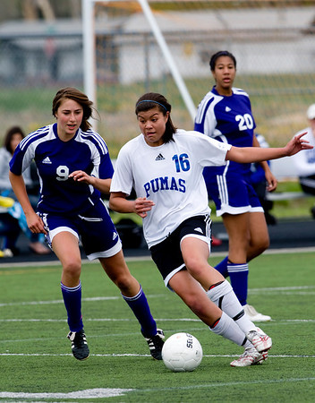 Peak to Peak's Gavriel Roda (right) dribbles the ball while Basalt's Nettie Stenstadvold defends during their game at Peak to Peak high school in Lafayette, Saturday, May 15, 2010. <br /> <br /> <br /> <br /> Kasia Broussalian