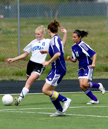 Peak to Peak's Alex Johnson (left) passes the ball while Basalt's Dani Chacon trails her during their game at Peak to Peak high school in Lafayette, Saturday, May 15, 2010. <br /> <br /> <br /> <br /> Kasia Broussalian