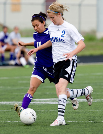 Peak to Peak's Isabelle Morel (right) and Basalt's and Dani Chacon fight over the ball during their game at Peak to Peak high school in Lafayette, Saturday, May 15, 2010. <br /> <br /> <br /> <br /> Kasia Broussalian
