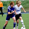 Peak to Peak's Rebecca Mitchell (right) and Basalt's Ginerva Moore fight over the ball during their game at Peak to Peak high school in Lafayette, Saturday, May 15, 2010. <br /> <br /> <br /> <br /> Kasia Broussalian