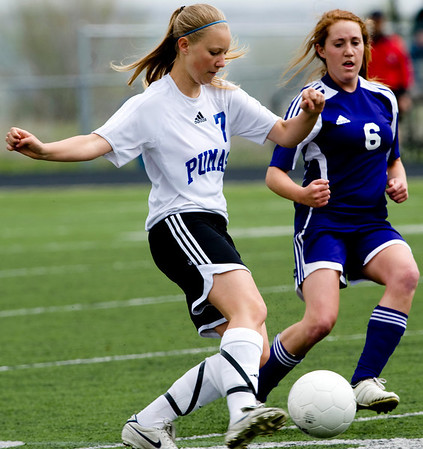 Peak to Peak's Shannon Henry (left) dribbles while Basalt's Ginevra Moore defends during their game at Peak to Peak high school in Lafayette, Saturday, May 15, 2010. <br /> <br /> <br /> <br /> Kasia Broussalian