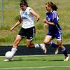 Peak to Peak's Emily Garnder (left) dribbles down the field while Basalt's Tori Kungli defends during their game at Peak to Peak high school in Lafayette, Saturday, May 15, 2010. <br /> <br /> <br /> <br /> Kasia Broussalian