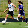 Peak to Peak's Emily Garnder (left) dribbles down the field while Basalt's Tori Kungli defends during their game at Peak to Peak high school in Lafayette, Saturday, May 15, 2010. <br /> <br /> <br /> <br /> Kasia Broussalian