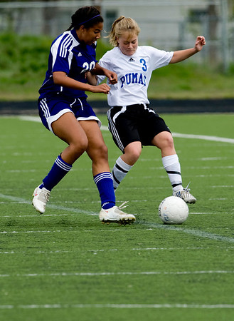 Peak to Peak's Rebecca Mitchell (right) and Basalt's Noel Chiarelli fight for possession of the ball during their game at Peak to Peak high school in Lafayette, Saturday, May 15, 2010. <br /> <br /> <br /> <br /> Kasia Broussalian