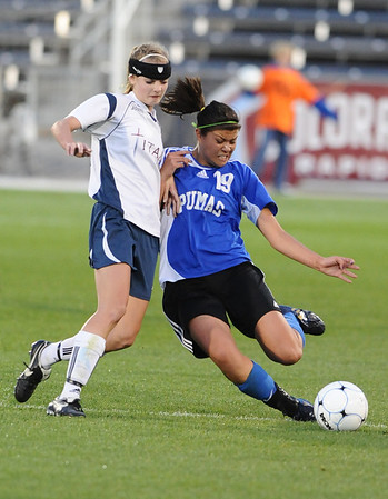 P2PTCA<br /> Peak to Peak's Gavriel Roda boots the ball away from Caitlyn Troupe of the Classical Academy.<br /> May 24, 1011
