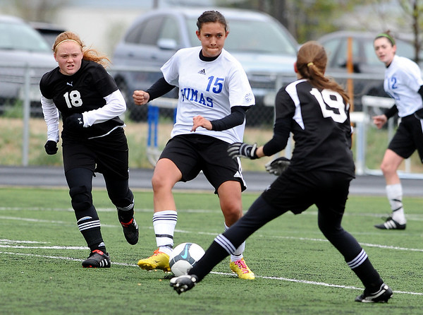 SOCCER<br /> Peak to Peak's Ivy DeVries, center, looks to pass while under pressure from Katrina Klawiter, left, and Anna Stevens of Aspen.<br /> Photo by Marty Caivano/May 11, 2011
