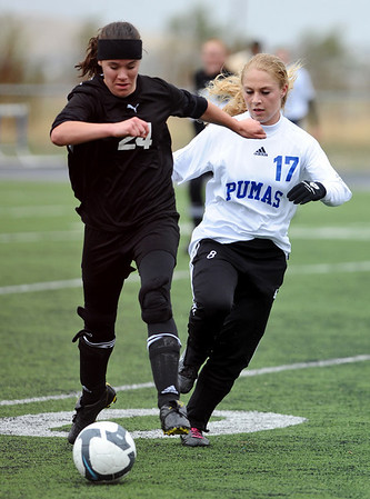 SOCCER<br /> Peak to Peak's Jillian Mitchell, right, chases for the ball against Annie Graber of Aspen.<br /> Photo by Marty Caivano/May 11, 2011