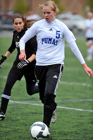 SOCCER<br /> Peak to Peak's Amanda Swanson fends off Anna Stevens of Aspen.<br /> Photo by Marty Caivano/May 11, 2011