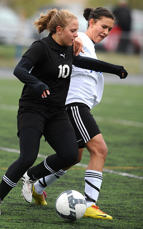 SOCCER<br /> Peak to Peak's Ivy DeVries, right, fights for control of the ball against Hayley Kremer of Aspen.<br /> Photo by Marty Caivano/May 11, 2011