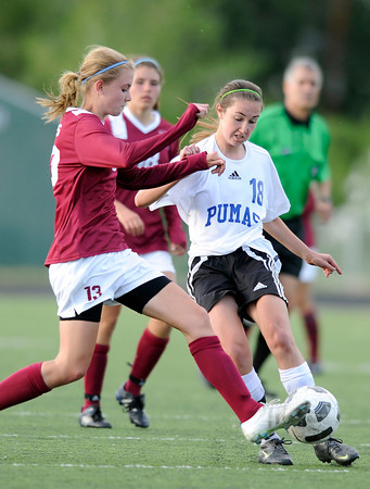 "Peak to Peak High School's Emily Gardner fights for the ball Meghan Troupe during a soccer game against Classical Academy at Peak to Peak Charter School in Lafayette on Thursday, May 17. For more photos of the game go to  <a href=""http://www.dailycamera.com"">http://www.dailycamera.com</a><br /> Jeremy Papasso/ Camera"