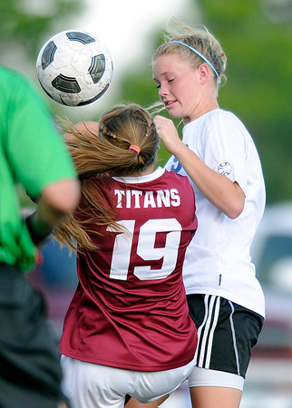 "Peak to Peak High School's Brynna Bostic, right, tries to head the ball over Sarah St. Louis during a soccer game against Classical Academy at Peak to Peak Charter School in Lafayette on Thursday, May 17. For more photos of the game go to  <a href=""http://www.dailycamera.com"">http://www.dailycamera.com</a><br /> Jeremy Papasso/ Camera"