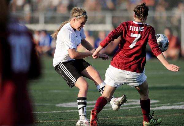 """Peak to Peak High School's Belle Morel takes a shot on goal past Sarah Turner during a soccer game against Classical Academy at Peak to Peak Charter School in Lafayette on Thursday, May 17. For more photos of the game go to  <a href=""""http://www.dailycamera.com"""">http://www.dailycamera.com</a><br /> Jeremy Papasso/ Camera"""