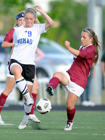 "Peak to Peak High School's Brynna Bostic fights for the ball with Sarah St. Louis during a soccer game against Classical Academy at Peak to Peak Charter School in Lafayette on Thursday, May 17. For more photos of the game go to  <a href=""http://www.dailycamera.com"">http://www.dailycamera.com</a><br /> Jeremy Papasso/ Camera"