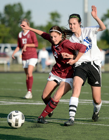 "Peak to Peak High School's Emily Gardner, right, fights for the ball with Joanie Jacks during a soccer game against Classical Academy at Peak to Peak Charter School in Lafayette on Thursday, May 17. For more photos of the game go to  <a href=""http://www.dailycamera.com"">http://www.dailycamera.com</a><br /> Jeremy Papasso/ Camera"
