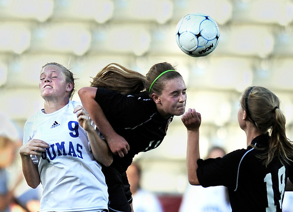 "Peak to Peak High School's Brynna Botic, No. 9, goes for a header against Marin McCoy during the Class 3A State Championship against Colorado Academy on Tuesday, May 22, at Dick's Sporting Good Park in Commerce City. Peak to Peak won 2-1. For more photos of the game go to  <a href=""http://www.dailycamera.com"">http://www.dailycamera.com</a><br /> Jeremy Papasso/ Camera"