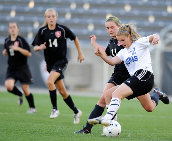 "Peak to Peak High School's Belle Morel, No. 2, fights to keep the ball away from Marin McCoy during the Class 3A State Championship against Colorado Academy on Tuesday, May 22, at Dick's Sporting Good Park in Commerce City. Peak to Peak won 2-1. For more photos of the game go to  <a href=""http://www.dailycamera.com"">http://www.dailycamera.com</a><br /> Jeremy Papasso/ Camera"
