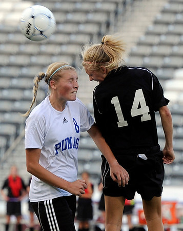 "Peak to Peak High School's Alex Johnson goes for a header against Colorado Academy's Ali Clark during the Class 3A State Championship against Colorado Academy on Tuesday, May 22, at Dick's Sporting Good Park in Commerce City. Peak to Peak won 2-1. For more photos of the game go to  <a href=""http://www.dailycamera.com"">http://www.dailycamera.com</a><br /> Jeremy Papasso/ Camera"