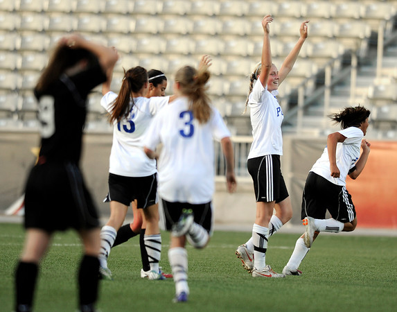 "Peak to Peak's Alex Johnson raises her hands in victory as Colorado Academy's Sarah Sibley, left, shows her emotions at the end of the Class 3A State Championship against Colorado Academy on Tuesday, May 22, at Dick's Sporting Good Park in Commerce City. Peak to Peak won 2-1. For more photos of the game go to  <a href=""http://www.dailycamera.com"">http://www.dailycamera.com</a><br /> Jeremy Papasso/ Camera"