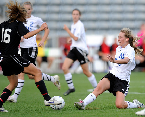 "Peak to Peak High School's Michaela Vanderheiden goes for a slide tackle on Colorado Academy's Mandy Weeks during the Class 3A State Championship against Colorado Academy on Tuesday, May 22, at Dick's Sporting Good Park in Commerce City. Peak to Peak won 2-1. For more photos of the game go to  <a href=""http://www.dailycamera.com"">http://www.dailycamera.com</a><br /> Jeremy Papasso/ Camera"