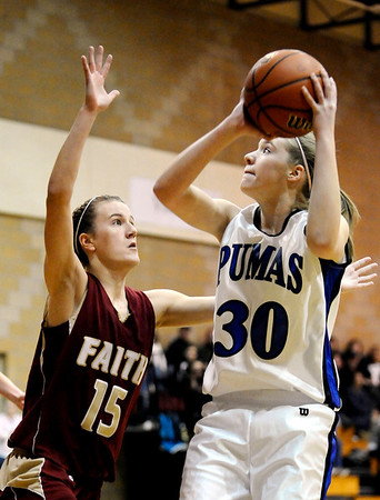 Peak to Peak's Caroline Clark (right) takes a shot over Faith Christian's  Jenny Lawler (left) during their basketball game at Peak to Peak High School in Lafayette, Colorado February 4, 2010.  CAMERA/Mark Leffingwell