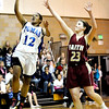 Peak to Peak's Khadijah Sayyid (left) slips by Faith Christian's Hannah Blum (right) for 2 points during their baskeball game at Peak to Peak High School in Lafayette, Colorado February 4, 2010.  CAMERA/Mark Leffingwell