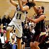 Peak to Peak's Ally Hatch (left) scores while under pressure from Faith Christian's Megan Jay (right) during their baskeball game at Peak to Peak High School in Lafayette, Colorado February 4, 2010.  CAMERA/Mark Leffingwell